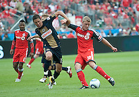 Philadelphia Union midfielder/forward Kyle Nakazawa #13 and Toronto FC forward Nick Soolsma #18 in action during an MLS game between the Philadelphia Union and the Toronto FC at BMO Field in Toronto on May 28, 2011..The Philadelphia Union won 6-2..