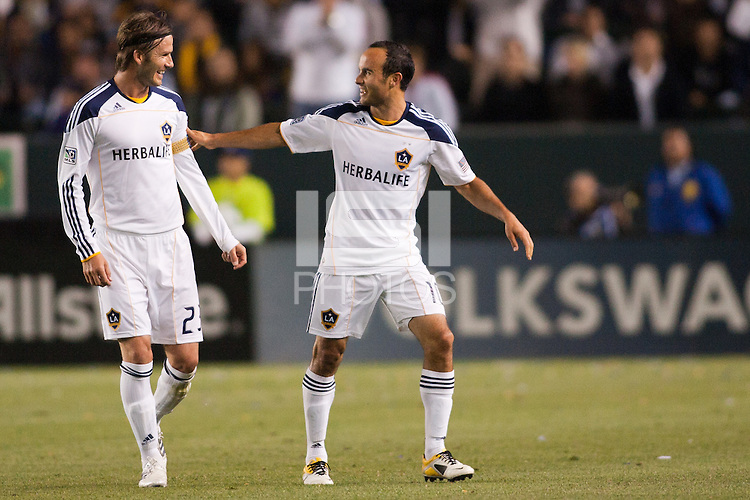 Landon Donovan (10) finishes installing the Captain armband on David Beckham (23) as Donovan exits the pitch late in the match. The LA Galaxy defeated the Portland Timbers 3-0 at Home Depot Center stadium in Carson, California on  April  23, 2011....