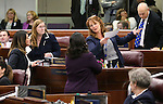 Nevada Assembly Democrats, from left, Teresa Benitez Thompson, Maggie Carlton, Irene Bustamante Adams and Marilyn Kirkpatrick talk on the Assembly floor in the final chaotic minutes of the session at the Legislative Building in Carson City, Nev., on Monday, June 1, 2015. <br /> Photo by Cathleen Allison