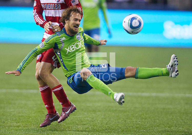 Seattle Sounders FC midfielder Roger Levesque get airborne during play against FC Dallas at Qwest Field in Seattle Saturday May 14, 2011. Dallas won the game 1-0.