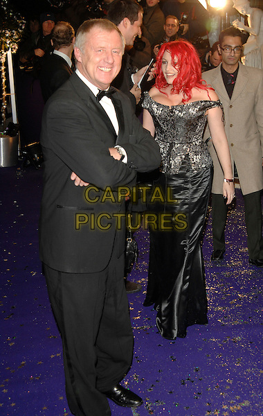 CHRIS TARRANT & JANE ROSS (GOLDMAN).British Comedy Awards 2006, London Television Studios, London, UK. .December 13th, 2006.full length black tuxedo off the shoulder dress silver.CAP/PL.©Phil Loftus/Capital Pictures