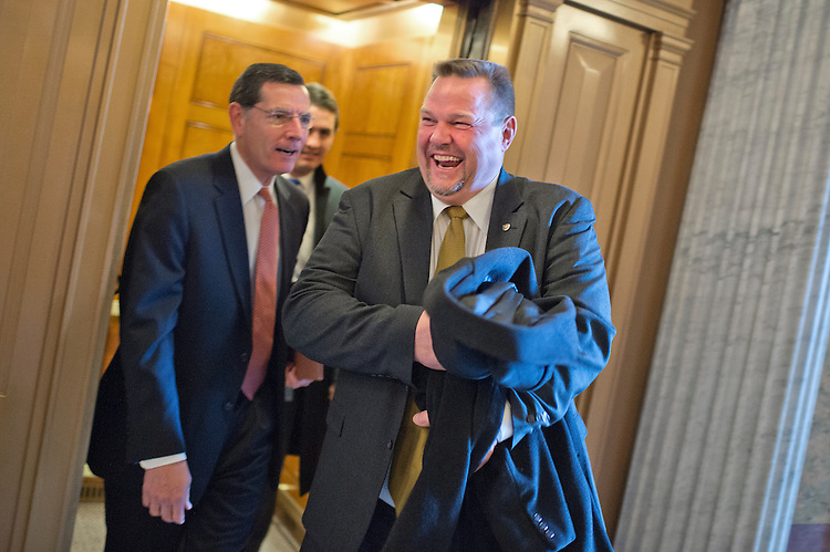 UNITED STATES - JANUARY 07: Sens. John Barrasso, R-Wyo., left, and Jon Tester, D-Mont., share a laugh before the senate luncheons in the Capitol, January 7, 2015. (Photo By Tom Williams/CQ Roll Call)