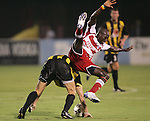 7 August 2007: FC Dallas's Dominic Oduro (front) loses his balance from the challenge of Charleston's Stephen Armstrong (behind). FC Dallas of Major League Soccer defeated the Charleston Battery of the United Soccer League first division 2-1 after extra time in a quarterfinal match of the 2007 US Open Cup tournament at Blackbaud Stadium in Charleston, SC...