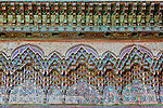 Colorful painted wood carvings inside the Kasbah Telouet in Morocco.