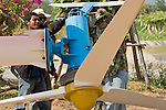 Workers repair a wind turbine that was damaged in a monsoon on the King's Wind Farm in Thailand. The farm is owned and operated by Prapai Technologies.