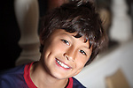 Young smiling boy with shallow depth of field