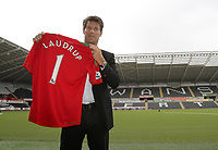 Michael Laudrup is official unveiled as the new manager of Swansea City FC in a press conference at the Liberty Stadium, today, 21/06/12<br /> Pictured: Michael Laudrup poses with a swansea city shirt.<br /> Picture by: Ben Wyeth / Athena Picture Agency