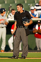 Home plate umpire Andy Draper between innings of the South Atlantic League game between the Hagerstown Suns and the Kannapolis Intimidators at Fieldcrest Cannon Stadium on May 31, 2011 in Kannapolis, North Carolina.   Photo by Brian Westerholt / Four Seam Images