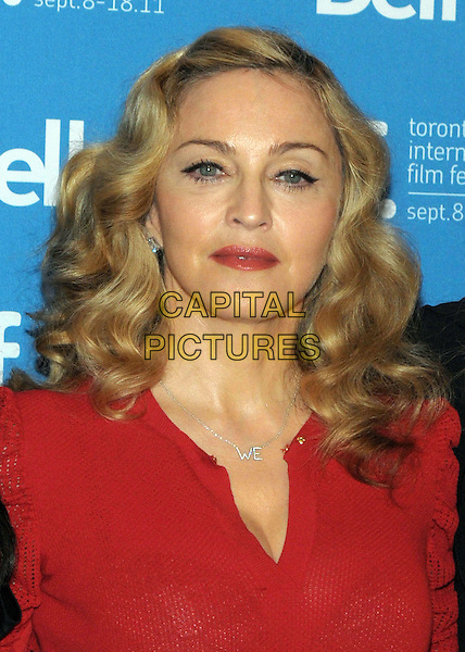 "Madonna.""W.E."" Press Conference  - 2011 Toronto International Film Festival held at  TIFF Bell Lightbox, Toronto, Ontario, Canada..September 12th, 2011.headshot portrait red necklace silver letters  .CAP/ADM/BPC.©Brent Perniac/AdMedia/Capital Pictures."