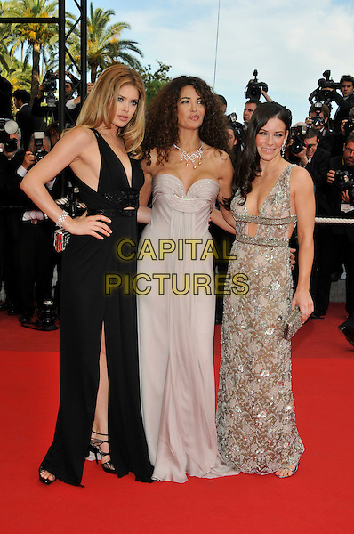 Doutzen Kroes, Afef Jnifen, Evangeline Lilly.'Vengance' screening.62nd International Cannes Film Festival.Cannes, France. 17th May 2009.full length black slit split dress grey gray strapless cleavage thigh leg clutch bag silver patterned hand on hip.CAP/PL.©Phil Loftus/Capital Pictures