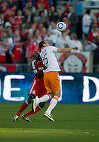 07 May2011: Houston Dynamo forward Cam Weaver #15 and Toronto FC defender Dicoy Williams #31 in action during an MLS game between the Houston Dynamo and the Toronto FC at BMO Field in Toronto, Ontario.