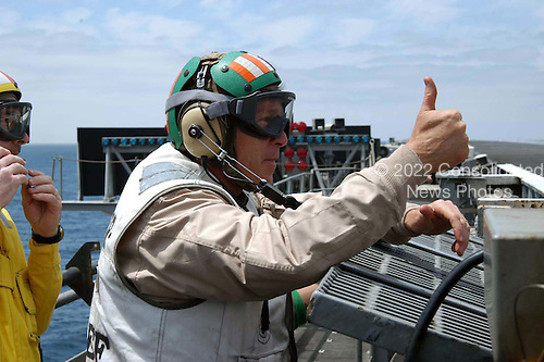 United States President George W. Bush gives a thumbs up before the launch of an aircraft on the flight deck of USS Abraham Lincoln on May 1, 2003.  The President is conducting a visit aboard ship to meet with the Sailors and will address the Nation as Lincoln prepares to return from a 10-month deployment to the Arabian Gulf in support of Operation Iraqi Freedom. <br /> Credit: United States Navy via CNP