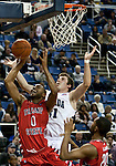 January 21, 2012:   Nevada Wolf Pack forward Olek Czyz fights for the rebound against Fresno State Bulldogs forward Jerry Brown III during their NCAA basketball game played at Lawlor Events Center on Saturday night in Reno, Nevada.