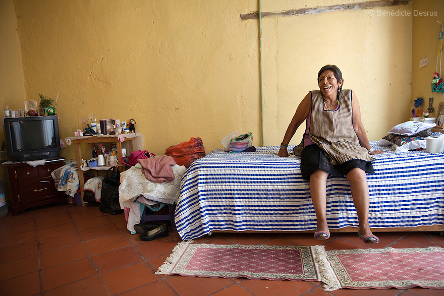 Portrait of Luchita, a resident of Casa Xochiquetzal, in her bedroom at the shelter in Mexico City, Mexico on July 11, 2013. Casa Xochiquetzal is a shelter for elderly sex workers in Mexico City. It gives the women refuge, food, health services, a space to learn about their human rights and courses to help them rediscover their self-confidence and deal with traumatic aspects of their lives. Casa Xochiquetzal provides a space to age with dignity for a group of vulnerable women who are often invisible to society at large. It is the only such shelter existing in Latin America. Photo by Bénédicte Desrus