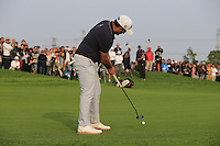 Alexander Levy (FRA) takes his putt at the 16th green from the crowd during Sunday's Final Round of the 2014 BMW Masters held at Lake Malaren, Shanghai, China. 2nd November 2014.<br /> Picture: Eoin Clarke www.golffile.ie