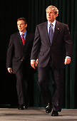Thurmont, MD - March 27, 2003 -- United States President George W. Bush and British Prime Minister Tony Blair walk to the podium as they met reporters at Camp David, Maryland on March 27, 2003 following their talks on the progress of the Iraq War.<br /> Credit: Ron Sachs / Pool via CNP