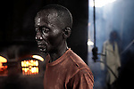 LUKUTU, DEMOCRATIC REPUBLIC OF CONGO MARCH 17: An unidentified man works in a palm oil factory on March 17, 2006 in Lukutu, Congo, DRC. Lukutu is a small village along the Congo River, about 1500 kilometers from Kinshasa, the capital. The factory is a big producer of palm oil, which is mainly used for cooking. The Belgians built the factory in 1911 and it was closed during the recent civil war. About 10,000 people are dependent on the factory, the only one in the area. Congo River is a lifeline for millions of people, who depend on it for transport and trade. During the Mobuto era, big boats run by the state company ONATRA dominated the traffic on the river. These boats had cabins and restaurants etc. All the boats are now private and are mainly barges that transport goods. The crews sell tickets to passengers who travel in very bad conditions, mixing passengers with animals, goods and only about two toilets for five hundred passengers. The conditions on the boats often resemble conditions in a refugee camp. Congo is planning to hold general elections by July 2006, the first democratic elections in forty years. (Photo by Per-Anders Pettersson)