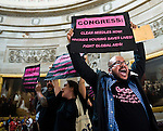 AIDS activists hold signs, chant and chain themselves together during a protest in the U.S. Capitol Rotunda on July 9, 2009. U.S. Capitol Police cleared the area of tourists and media before arresting the group.