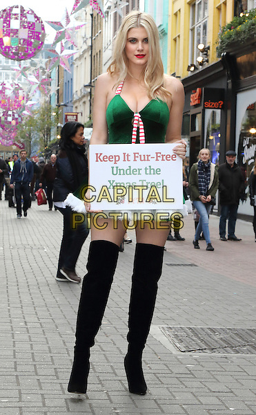 LONDON, ENGLAND - Dressed as Santa's Little Helper, Ashley James teamed up with PETA to encourage shoppers in London's trendy Carnaby Street to 'Keep it Fur Free under the Christmas Tree' this year, London December 14th 2015<br /> CAP/ROS<br /> &copy;ROS/Capital Pictures