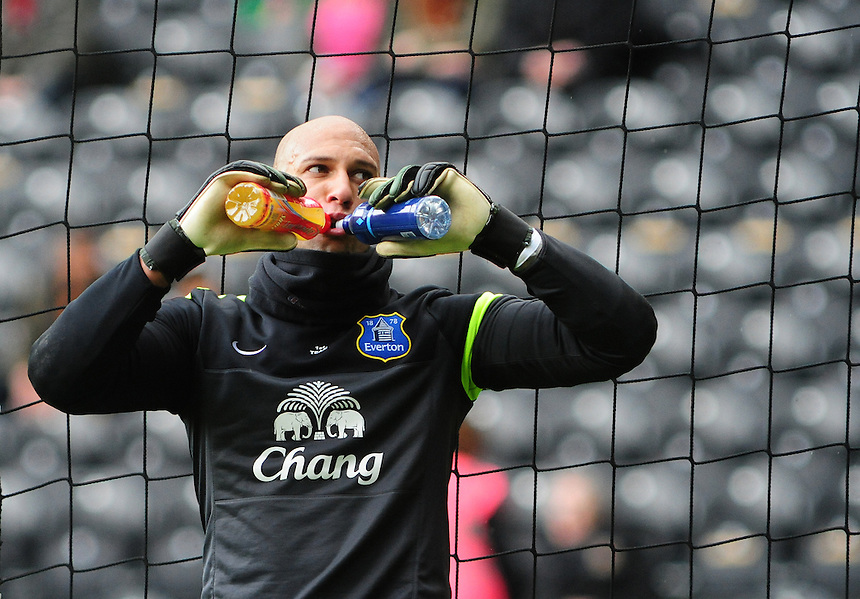 Everton's Tim Howard has a drink during the pre-match warm-up <br /> <br /> Photographer Chris Vaughan/CameraSport<br /> <br /> Football - Barclays Premiership - Hull City v Everton - Sunday 11th May 2014 - Kingston Communications Stadium - Hull<br /> <br /> &copy; CameraSport - 43 Linden Ave. Countesthorpe. Leicester. England. LE8 5PG - Tel: +44 (0) 116 277 4147 - admin@camerasport.com - www.camerasport.com