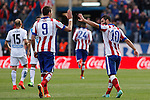 Atletico de Madrid´s Arda Turan celebrates a goal with Mandzukic during 2014-15 La Liga match between Atletico de Madrid and Deportivo de la Coruña at Vicente Calderon stadium in Madrid, Spain. November 30, 2014. (ALTERPHOTOS/Victor Blanco)
