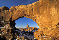 Turret Arch viewed through North Window, Arches National Park, Utah.