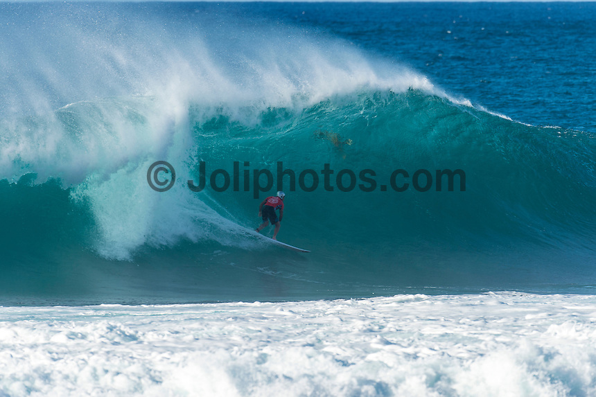 BANZAI PIPELINE, Oahu/Hawaii (Friday, December 12, 2014) Tom Carroll (AUS) - The final stop of the 2014  World Championship Tour, the Billabong Pipe Masters in Memory of Andy Irons, was  called ON today in double overhead surf. <br /> <br /> Competition began with the final of Men's Pipe Masters Invitational. It had been a 32-man event comprising of local Pipe specialists competing for a US$100,000 prize purse as well as two wildcard positions in the Billabong Pipe Masters. <br /> Reef MacIntosh (HAW) and Makai McNamara (HAW) who moved into the main event.<br /> IN the World Title showdown both Mick Fanning (AUS) and Gabriel Medina (BRA) won their heats today  and moved straight into Round 3 while Kelly Slater (USA) lost his heat and will have to surf in the sudden death Round 2.<br /> The Billabong Pipe Masters in Memory of Andy Irons will determine this year&rsquo;s world surfing champion as well as those who qualify for the elite tour in 2015. As the third and final stop on the Vans Triple Crown of Surfing Series  the event will also determine the winner of the revered three-event leg.<br /> <br /> The ASP Heritage Series, which celebrates the rich culture and history of professional surfing, had it's third and final competitive event of the season today with a four-man heat between Gary Elkerton (AUS), Tom Carroll (AUS), Derek Ho (HAW) and Sunny Garcia (HAW). Carroll dominated the final with Garcia in 2nd , Ho  3rd and Elekerton 4th.<br /> <br /> The world&rsquo;s best female surfers also competed at Pipeline this afternoon in the Women&rsquo;s Pipe Masters Invitational with reigning six-time  Women&rsquo;s World Champion Stephanie Gilmore (AUS) finished in 4th while two-time Women&rsquo;s World Champion Carissa Moore (HAW) easily won the heat., Australian powerhouse Tyler Wright (AUS) was 2nd and international icon Bethany Hamilton (HAW)  finished 3rd. Photo: joliphotos.com