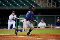 Mississippi Braves second baseman Travis Demeritte (11) follows through on a swing during a game against the Montgomery Biscuits on April 24, 2017 at Montgomery Riverwalk Stadium in Montgomery, Alabama.  Montgomery defeated Mississippi 3-2.  (Mike Janes/Four Seam Images)