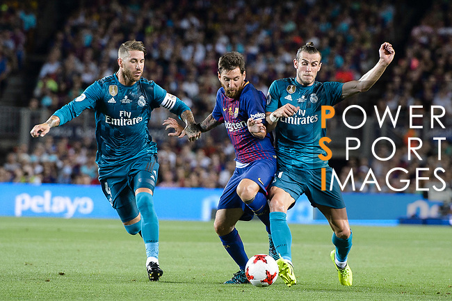 Lionel Messi of FC Barcelona (C) dribbles Gareth Bale (R) and Sergio Ramos of Real Madrid (L) during the Supercopa de Espana Final 1st Leg match between FC Barcelona and Real Madrid at Camp Nou on August 13, 2017 in Barcelona, Spain. Photo by Marcio Rodrigo Machado / Power Sport Images