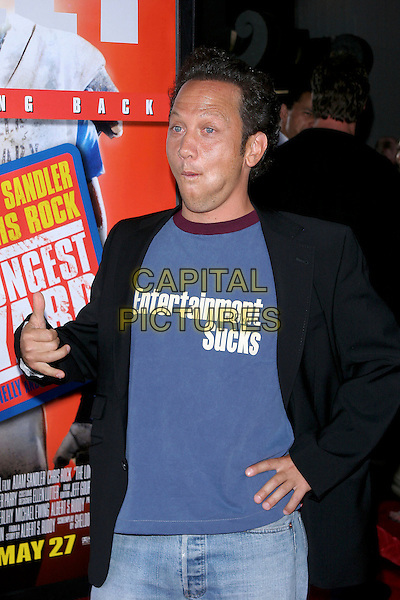 "ROB SCHNEIDER.World Premiere of ""The Longest Yard"" held at Grauman's Chinese Theatre..May 19th, 2005.Photo Credit: Jacqui Wong/AdMedia.half length hand on hip ""Entertainment Weekly Sucks"" logo slogan funny gesture.www.capitalpictures.com.sales@capitalpictures.com.© Capital Pictures."