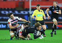 Ospreys' Jeff Hassler is tackled by Cardiff Blues' Owen Lane and Josh Navidi.<br /> <br /> Photographer Dan Minto/CameraSport<br /> <br /> Guinness Pro14 Round 13 - Ospreys v Cardiff Blues - Saturday 6th January 2018 - Liberty Stadium - Swansea<br /> <br /> World Copyright &copy; 2018 CameraSport. All rights reserved. 43 Linden Ave. Countesthorpe. Leicester. England. LE8 5PG - Tel: +44 (0) 116 277 4147 - admin@camerasport.com - www.camerasport.com