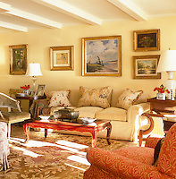 The low-ceilinged sunny living room is comfortably furnished