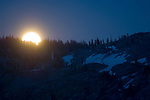 Full moon rising in evening over mountain ridge, Desolation Wilderness, El Dorado National Forest, California