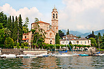 Chiesa di San Lorenzo with sailboats in front on Lake Como, Italy