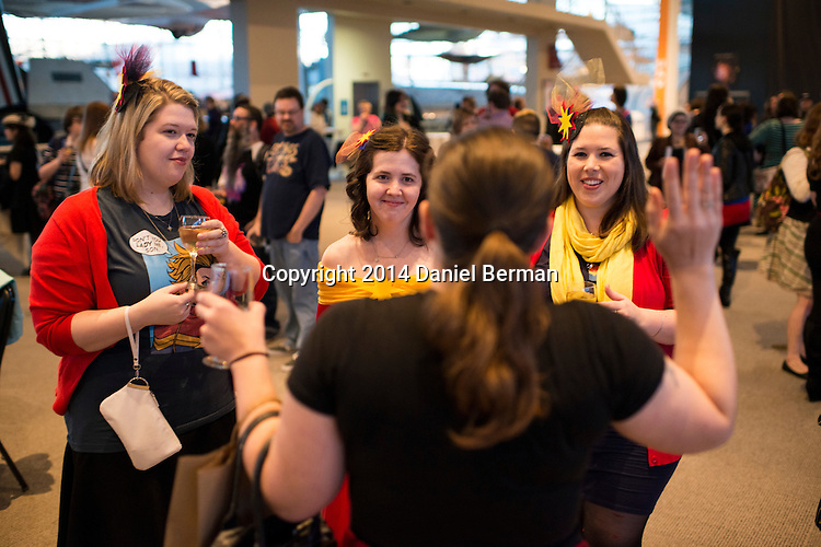 L-R, Jennifer DePrey of Lake Stevens, Wash., Ari Crossby and Pippa Adams of Vancouver, B.C., have a laugh with a friend as fans of the Captain Marvel and Ms. Marvel comics hang out during the Carol Corps Celebration Thursday March 27, 2014 at the Museum of Flight in Seattle. Held the day before Emerald City Comicon kicked off, the event raised funds for Girls Leadership Institute and offered a chance for fans to meet and chat with Captain Marvel writer Kelly Sue DeConnick and Ms. Marvel writer G. Willow Wilson. Photo by Daniel Berman for WIRED.com