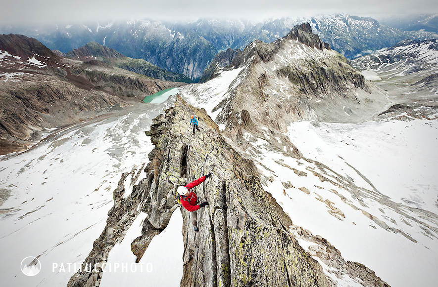 Two alpine climbers on the Swiss Alps ridge traverse of the Grosser Diamantstock in the Berner Oberland. Grimsel Pass, Switzerland