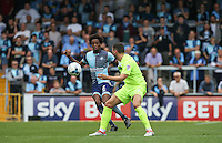 Sido Jombati of Wycombe Wanderers takes the ball from Drey Wright of Colchester United during the Sky Bet League 2 match between Wycombe Wanderers and Colchester United at Adams Park, High Wycombe, England on 27 August 2016. Photo by Andy Rowland.