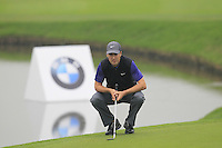 Ross Fisher (ENG) on the 3rd green during Thursday's Round 1 of the 2014 BMW Masters held at Lake Malaren, Shanghai, China 30th October 2014.<br /> Picture: Eoin Clarke www.golffile.ie
