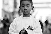A young martial artist marches in the Chinese New Year's parade in washington, DC.