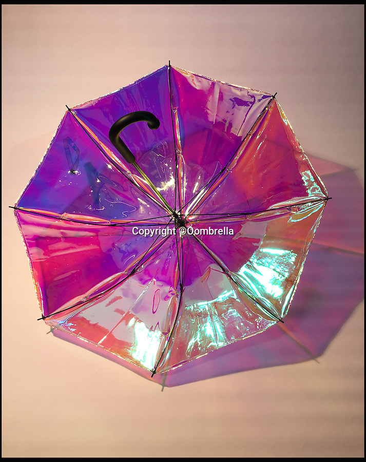 BNPS.co.uk (01202 558833)<br /> Pic: Oombrella/BNPS<br /> <br /> This eye-catching umbrella looks set to take the world by storm - as it uses high-tech cloud technology to predict weather and texts you if you are about to forget it. <br /> <br /> The reflective multi-coloured Oombrella uses cutting-edge technology to record light, humidity, and temperature - before it is collated and analysed and broadcast back to smart phones, providing instant local weather updates. <br /> <br /> This transforms its customers into into mobile weather stations, which can predict rain half an hour before it hits.