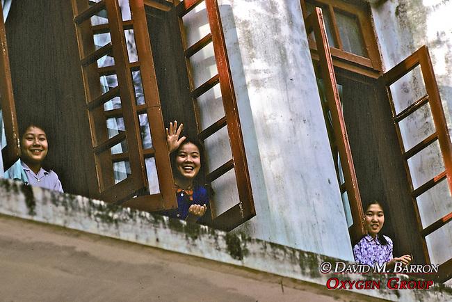 Girls Waving In Windows
