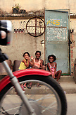 BRAZIL, Rio de Janiero, Favela, three children hanging outside in Complexo do Alemao, a neighborhood within the North Zone