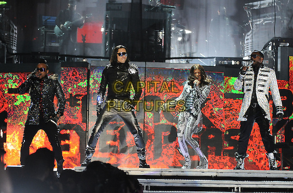 """APLE.DE.AP, TABOO, WILL.I.AM & FERGIE - BLACK EYED PEAS.(Allan Pineda Lindo, Jaime Luis Gomez, Stacy Ferguson, William James Adams, Jr.) .performs live at Staples Center as part of their """"The E.N.D. Tour"""" in Los Angeles, California, USA, March 29th, 2010..music band live on stage concert gig.full length space age silver suit costume catsuit glove arm microphone  singing side sunglasses fingerless gloves jacket military leather trousers glasses white metallic hand arm raised up singing    boots lace-up trainers sparkly glittery glitter spikes spiky shoulder studs                                       .CAP/RKE/DVS.©DVS/RockinExposures/Capital Pictures."""