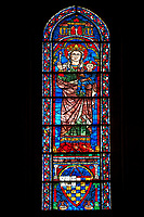 Medieval Window of the South Transept of the Gothic Cathedral of Chartres, France- Circa 1225-30. A UNESCO World Heritage Site. This window was a donation of the Mauclerc family, the Counts of Dreux-Bretagne, who are depicted with their arms in the bases of the lancets above is the Virgin Mary & Child