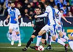 Lucas Vazquez (L) of Real Madrid fights for the ball with Gerard Gumbau Garriga (C) and Diego Rico Salguero of CD Leganes during the Copa del Rey 2017-18 match between CD Leganes and Real Madrid at Estadio Municipal Butarque on 18 January 2018 in Leganes, Spain. Photo by Diego Gonzalez / Power Sport Images