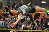 """Kelsey Shapiro of Longwood soars through the air during the high jump competition in the Suffolk County girls winter track and field state qualifiers at Suffolk Community College Grant Campus in Brentwood on Monday, Feb. 12, 2018. She won the event with a successful clear at 5'5""""."""