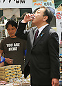 April 28, 2012, Tokyo, Japan - Japan's Prime Minister Yoshihiko Noda tastes Japanese rice wine produced in the nation's northeastern region stricken by the March 11 earthquake and tsunami during a May Day rally in Tokyo on Saturday, April 28, 2012. As a guest speaker, Noda addressed some 35,000 people attending the rally sponsored by the Japanese Trade Union Confederation. (Photo by Natsuki Sakai/AFLO) AYF -mis-