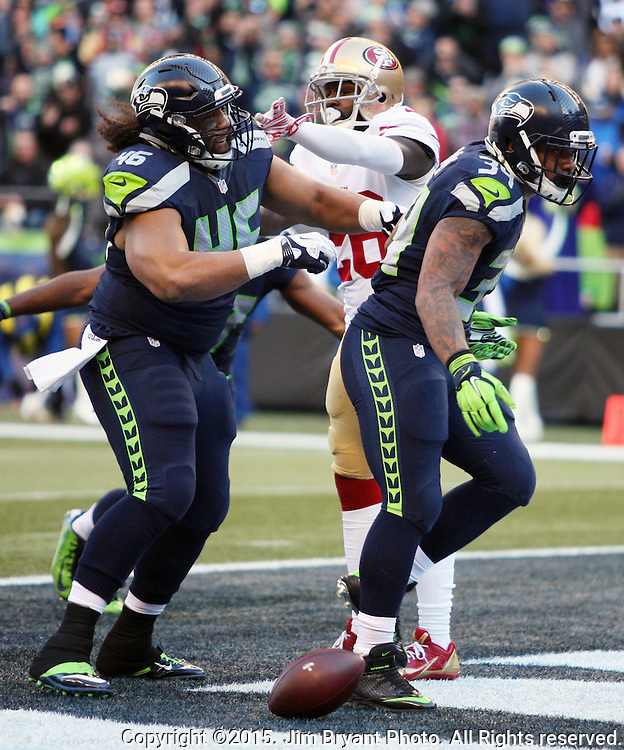 Seattle Seahawks full back Will Tukafu (46) celebrates running back Thomas Rawls'  (34) two-yard touchdown against the San Francisco 49ers at CenturyLink Field in Seattle, Washington on November 22, 2015.  The Seahawks beat the 49ers 29-13.   ©2015. Jim Bryant Photo. All RIghts Reserved.