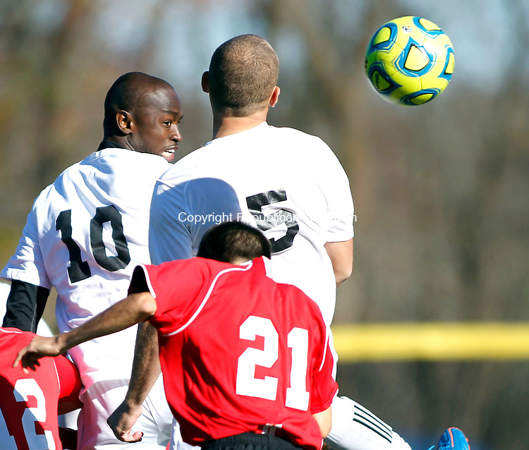 Waterbury, CT-04 November 2012-110412CM05-   Post's Francis Eno (10) heads the ball into the goal during the CACC championship game against Dominican Sunday afternoon in Waterbury.  The goal was called back after a foul on Post.  Also in the on the play is Post's Ani Lekaj (5) and Dominican's Manuel Valencia.  Post lost the championship game 3-2 on penalty kicks, after a 1-1 draw during regulation.  Christopher Massa Republican-American