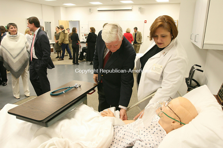 WINSTED, CT - 5 November, 2010 - 110510MO01 - Northwestern Connecticut Community College Director of Nursing Connie Hotchkiss shows Rep. John B. Larson, D-1st District, how the high-tech mannequins purchased with a federal grant will allow nursing students to take a pulse, and other vital signs, and even simulates patient responses to treatment. Larson was among several dignitaries who attended the grand opening Friday of the school's new nursing lab.  Jim Moore Republican-American.